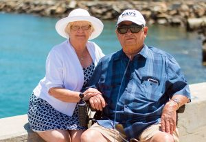 An elderly couple on a vacation using services of senior movers
