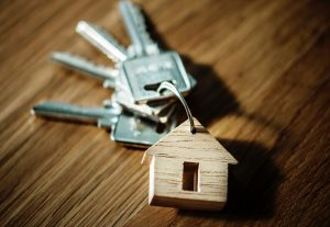 A set of keys with a house-shaped key ring.