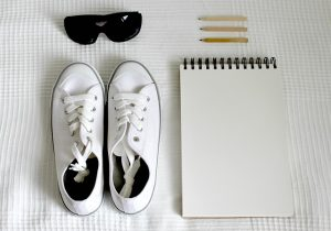 shoes, sunglasses and notepad