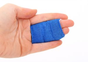 A bandage on fingers is a consequence of moving injuries