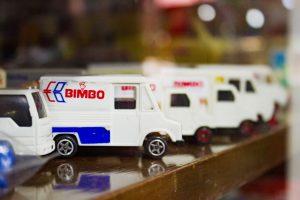 line of toy trucks