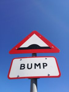 Bump on the road sign when piano moving