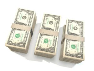 Stacks of dollar bills to pay for movers in Woodhaven NY.
