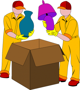 Movers putting lamps into a box.
