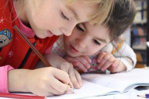 two children writing