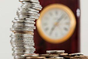 Stockpiled coins and a clock