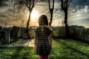 girl in a backyard