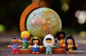 globe with dolls