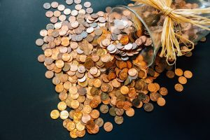 coins on a table representing a budget plan as one of the Modern home renovation tips