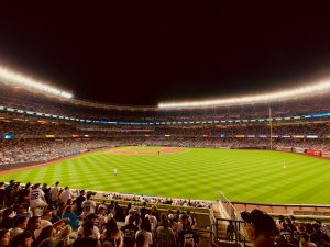 Yankee stadium is located in the Bronx, one of the Five Boroughs of NYC