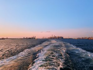 A boat ride from Manhattan towards the Staten Island, one of the Five Boroughs of NYC